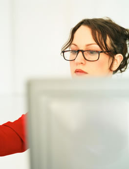 Woman at computer using Property Helix